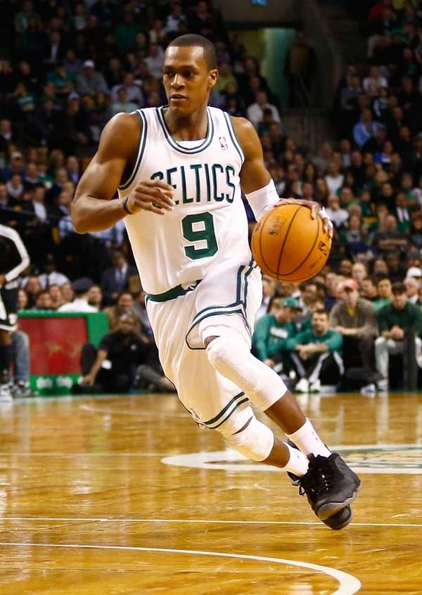 Boston Celtics guard Rajon Rondo drives to the