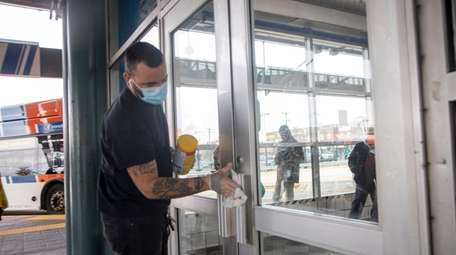 Workers clean the Rosa Parks NICE Bus terminal