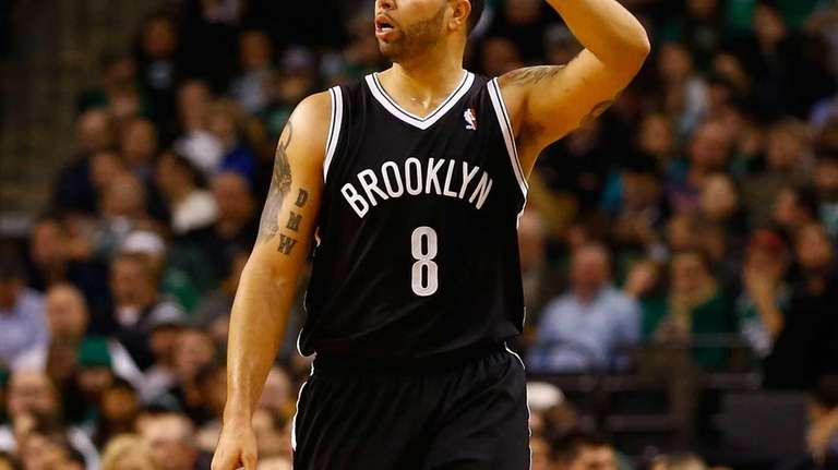 Deron Williams calls out a play while dribbling