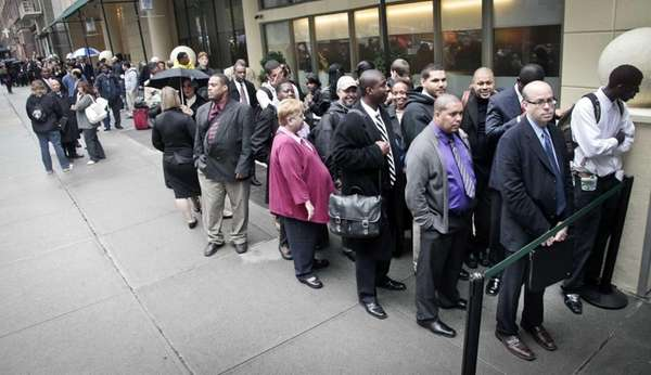 Job seekers wait in line to see employers