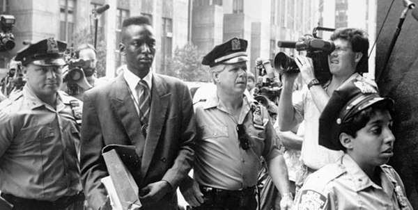 This film image released by Sundance Selects shows accused rapist Yusef Salaam being escorted by  police in New York in 1990. Salaam is the subject of the documentary,