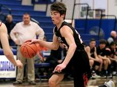 East Rockaway guard Aidan O'Connor drives the paint