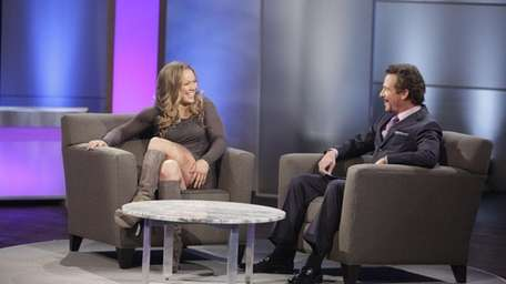 Ronda Rousey, left, shares a laugh with host