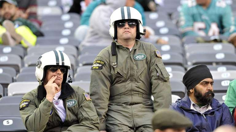 Jets fans are sullen during a game against