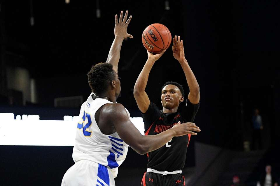 Northeastern guard Tyson Walker (2) shoots against Hofstra
