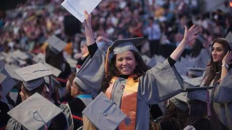 A graduate waves during Nassau Community College's Fifty