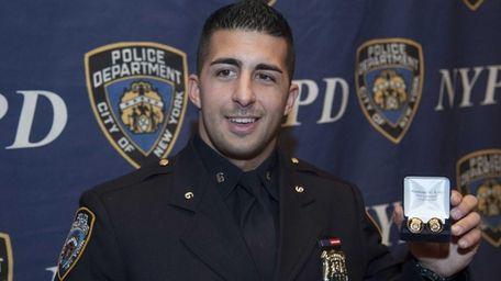 New York City Police Officer Larry DePrimo holds