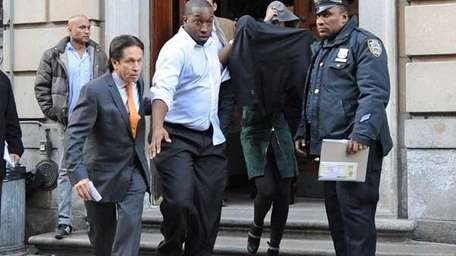 Lindsay Lohan is escorted from the 10th Precinct