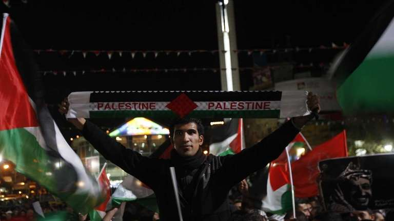 Palestinians wave Palestinian flags in the West Bank