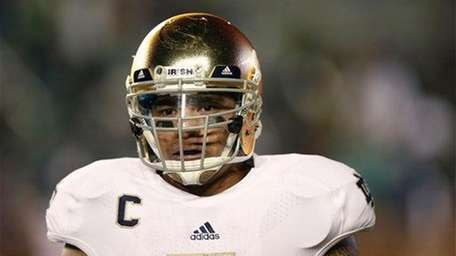 Notre Dame linebacker Manti Te'o looks on during