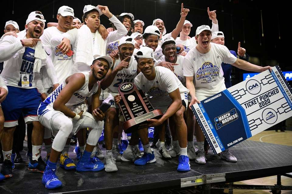 Hofstra players pose with the trophy after they