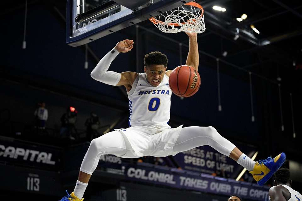 Hofstra guard Tareq Coburn (0) dunks during the