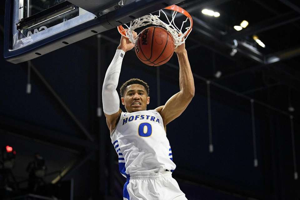 Hofstra guard Tareq Coburn dunks during the second