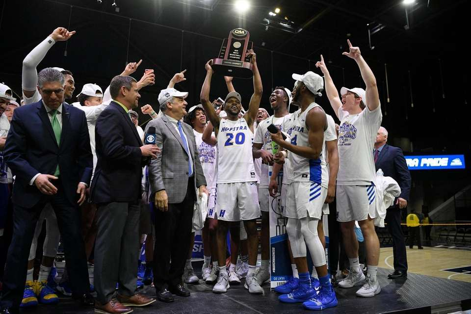 Hofstra guard Jalen Ray (20) and others raise