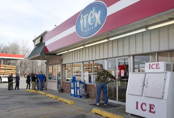 A customer enters Trex Mart as members of