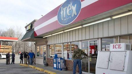 A customer enters Trex Mart as members of
