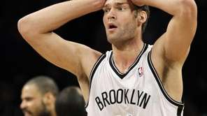 Brook Lopez reacts after causing an offensive foul