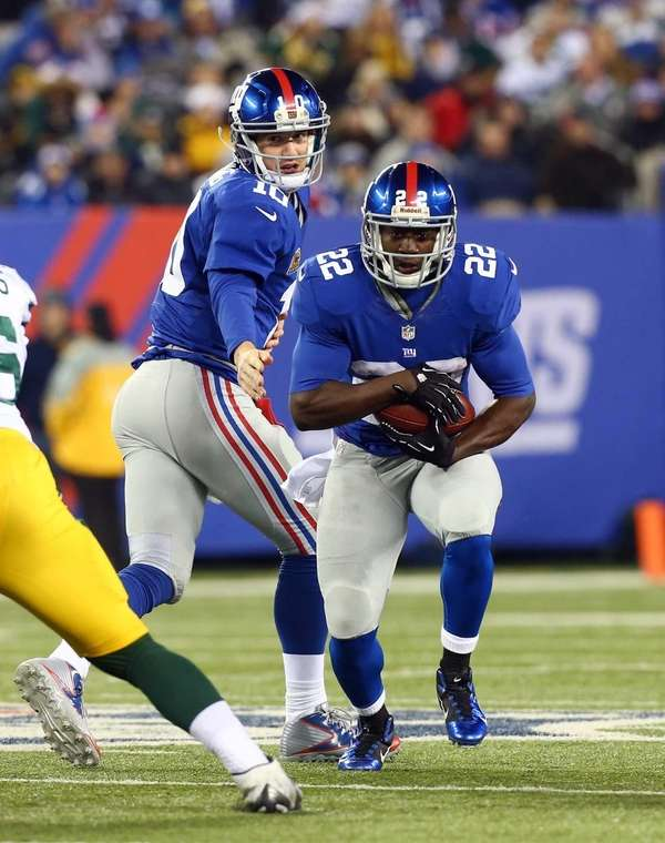 David Wilson takes the hand off from Eli