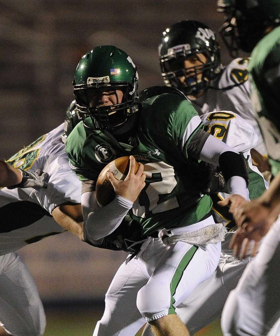 Farmingdale quarterback Joe Valente carries the ball against