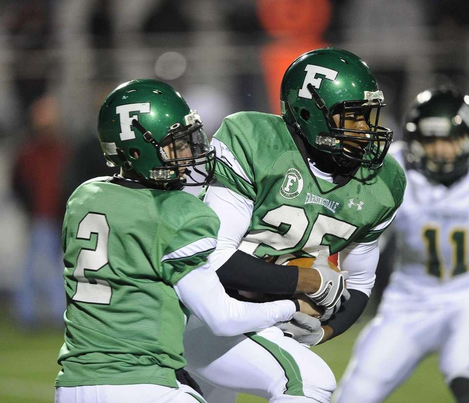 Farmingdale quarterback Vinny Quinn hands the ball off