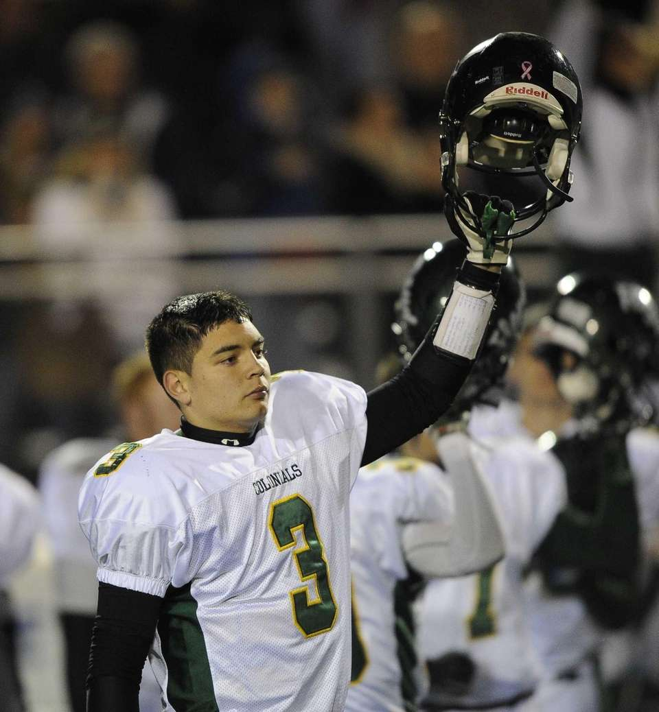 William Floyd quarterback A.J. Otranto raises his helmet