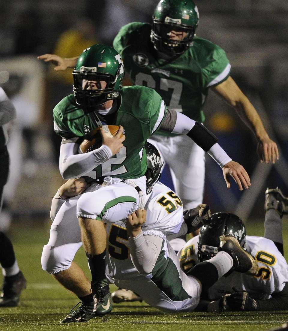 William Floyd's Matt Silva tackles Farmingdale quarterback Joe