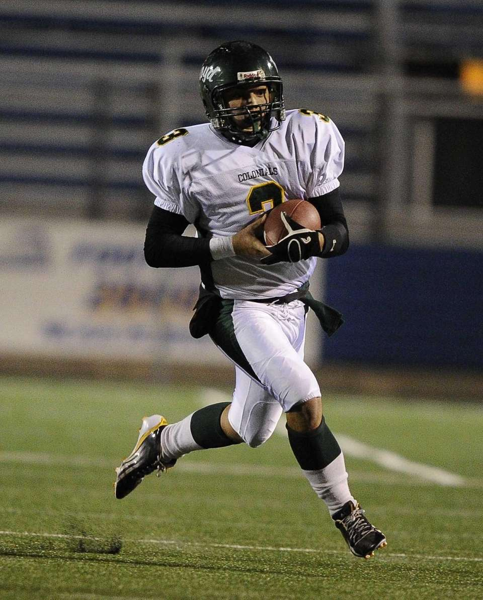 William Floyd quarterback A.J. Otranto carries the ball