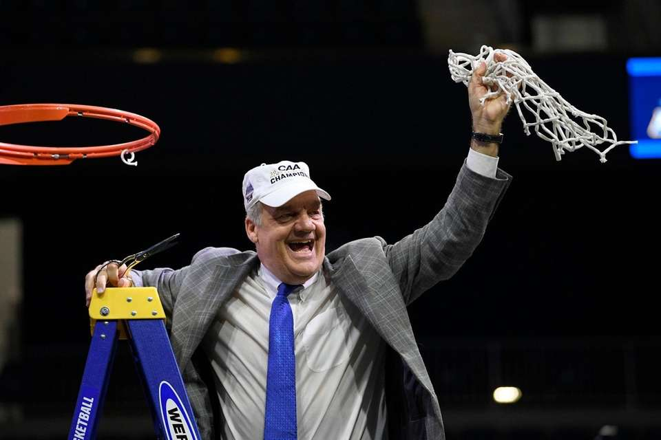 Hofstra coach Joe Mihalich after cutting down the