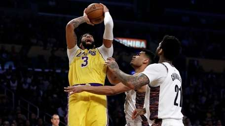 Los Angeles Lakers' Anthony Davis shoots over the