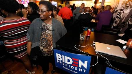 Joe Biden's supporters celebrate his victory Tuesday in
