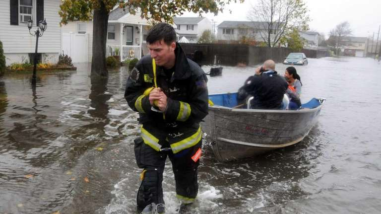 North Lindenhurst firefighters transport a family to safety