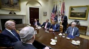 President Barack Obama hosts a meeting of the