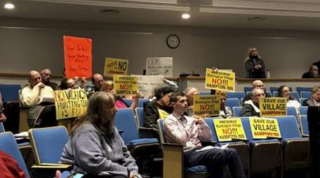 Opponents of a Hampton Inn attend the Huntington