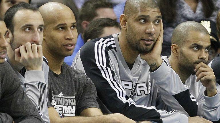 From left, the San Antonio Spurs' Manu Ginobili,