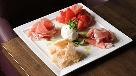 The M Bar platter with piles of prosciutto