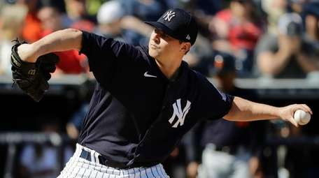 The Yankees' Zack Britton delivers a pitch during