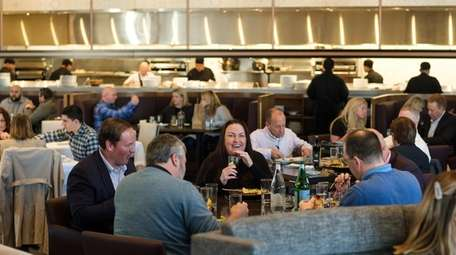 Patrons dine together in the massive and bustling
