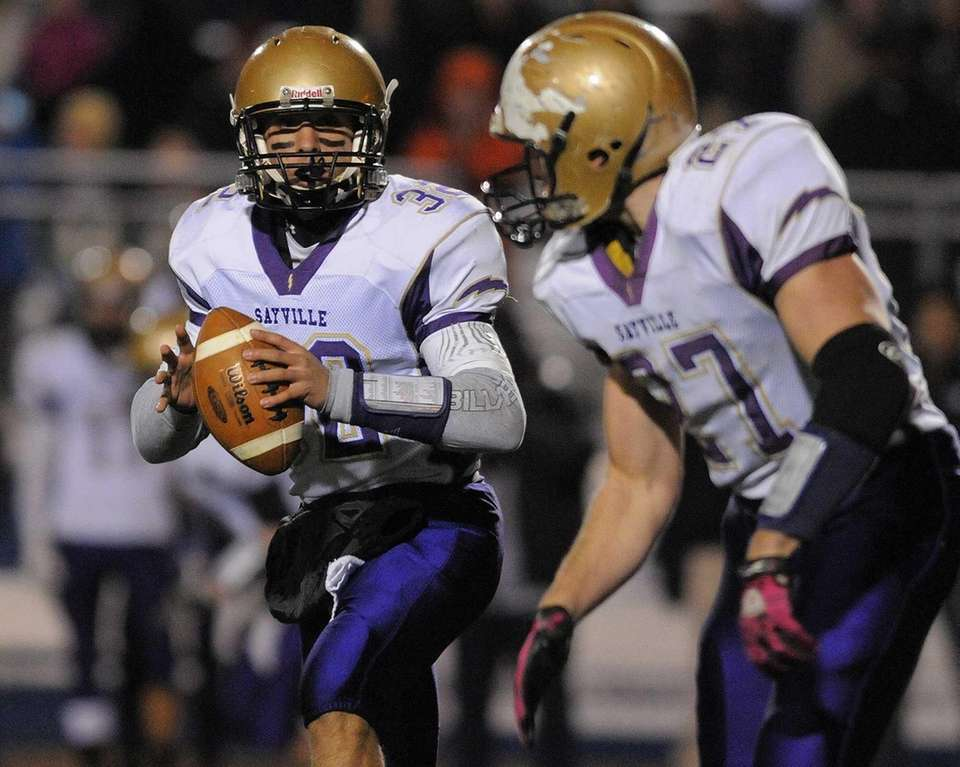 Sayville quarterback Zack Sirico, left, prepares to pitch