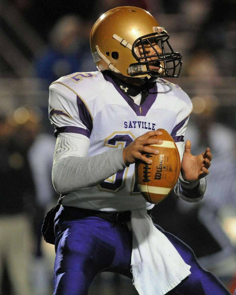Sayville quarterback Zack Sirico looks for an open