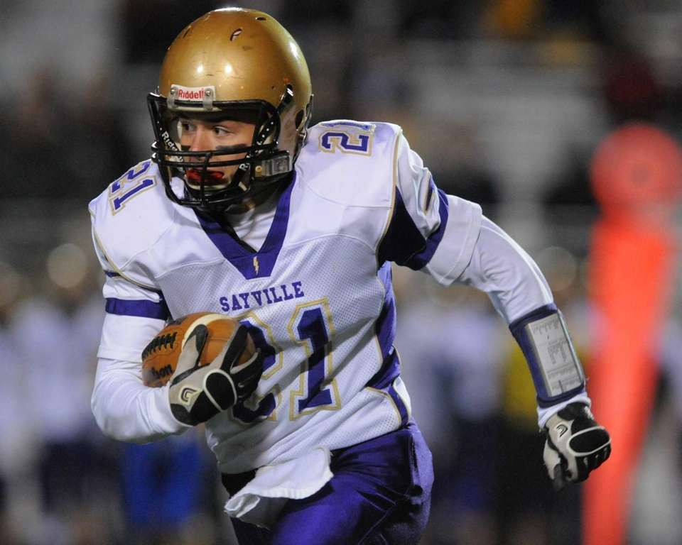 Sayville's Matthew Selts rushes for a gain in