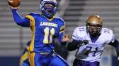 Lawrence quarterback Joe Capobianco throws a pass under