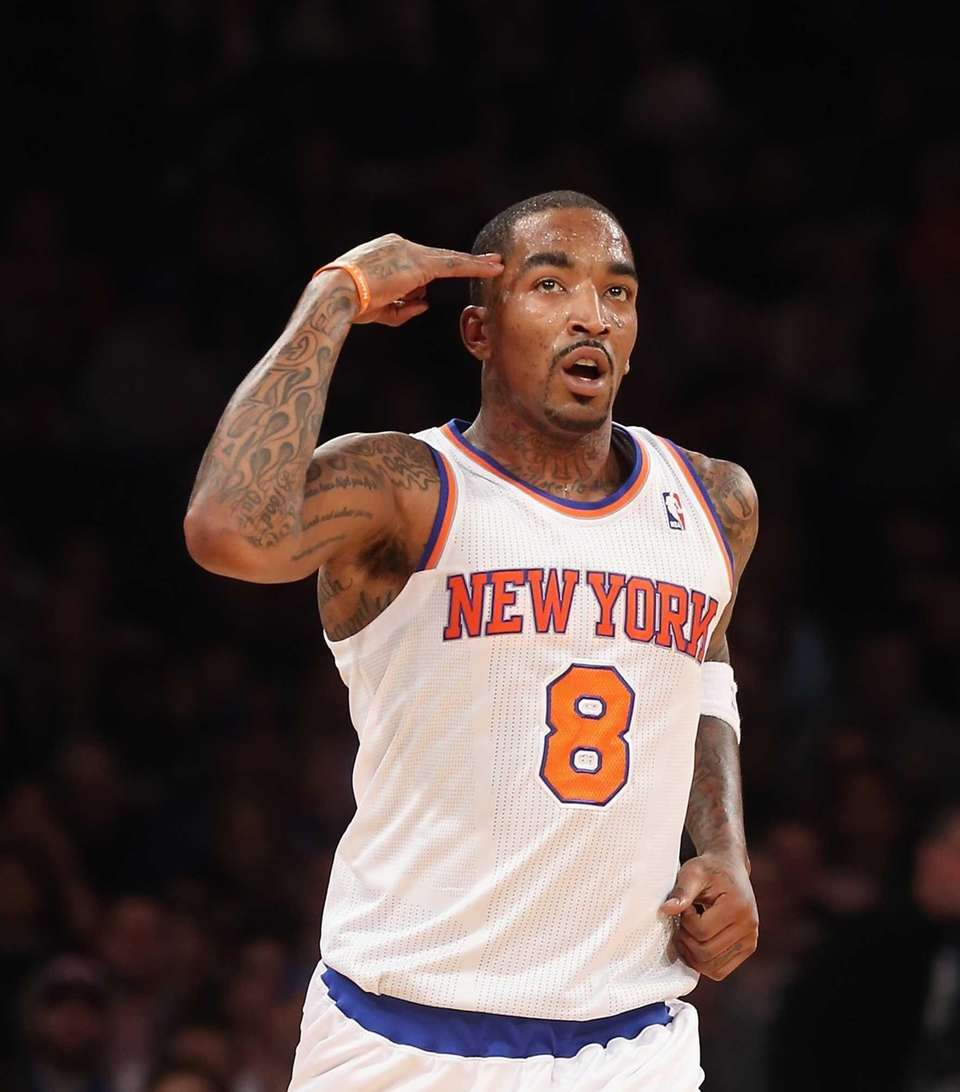 J.R. Smith signals after scoring a 3-pointer during
