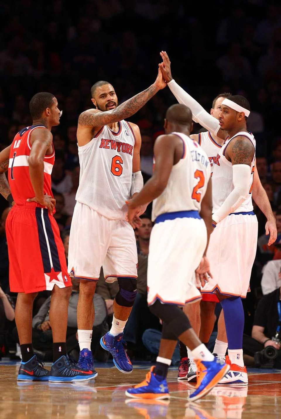 Tyson Chandler celebrates a basket with Carmelo Anthony