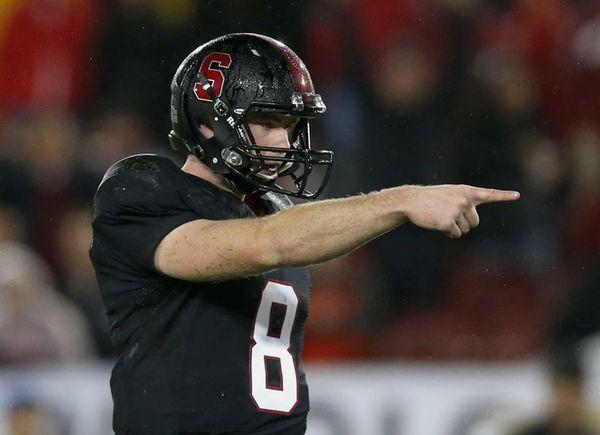 Stanford quarterback Kevin Hogan reacts after Stepfan Taylor