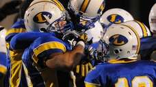 Lawrence players celebrate after their 21-20 win over