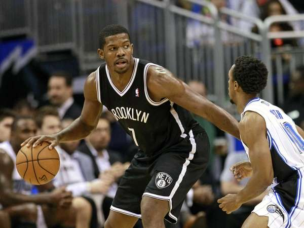 Joe Johnson looks to pass the ball around