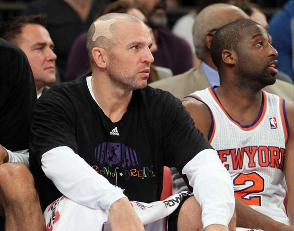 Jason Kidd looks on from the bench in