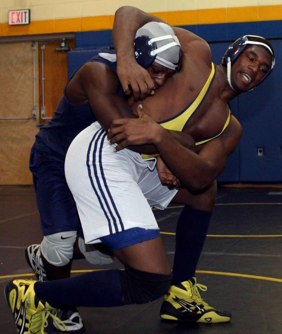 Alton Lucas, top, and Jovan Belcher wrestle during