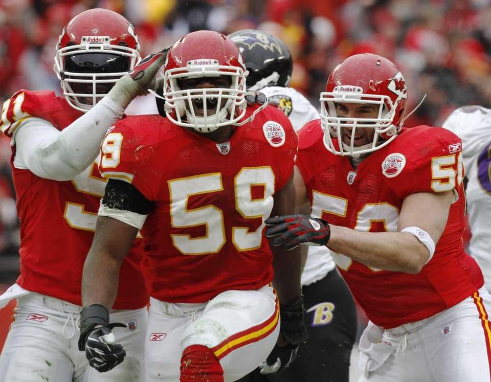 Kansas City Chiefs linebacker Jovan Belcher, center, reacts