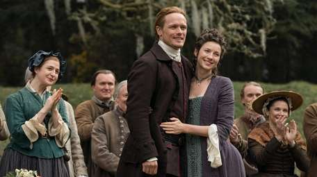 Sam Heughan as Jamie Fraser and Caitriona Balfe